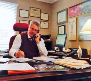 GJL at desk